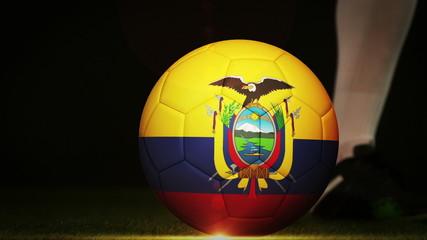 Football player kicking ecuador flag ball