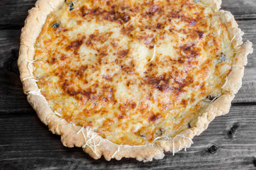 French quiche with onion, leek and mushrooms