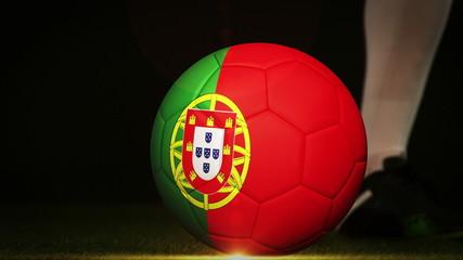 Football player kicking portugal flag ball