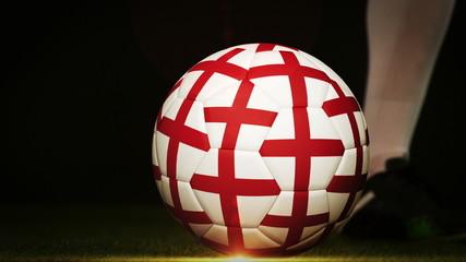 Football player kicking england flag ball