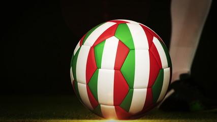 Football player kicking italy flag ball