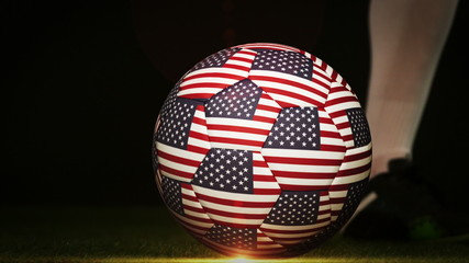 Football player kicking usa flag ball
