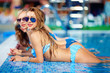 canvas print picture - seductive girls enjoy summer in pool