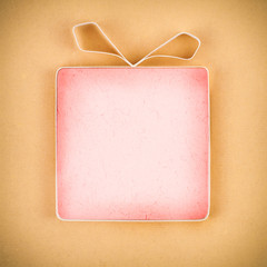 Hand made empty gift box, textured paper as background. Free spa