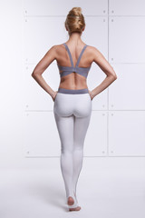 Sexy blonde perfect athletic slim figure yoga exercise fitness