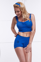 Young blonde dressed in style PinUp tanned body fitness sport