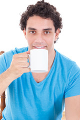 man in blue t-shirt sitting and drinking a cup of tea of coffee
