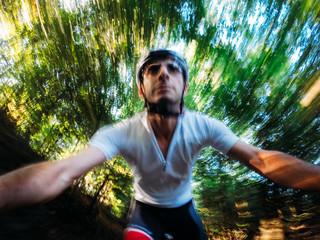 Front view of a mountain biker, motion blur effect.