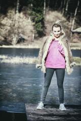 Teenage girl standing on the pier outdoor