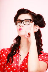 Retro. Pensive thoughtful pinup girl in eyeglasses