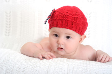 adorable baby girl in hat