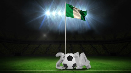 Nigeria national flag waving on flagpole with 2014 message