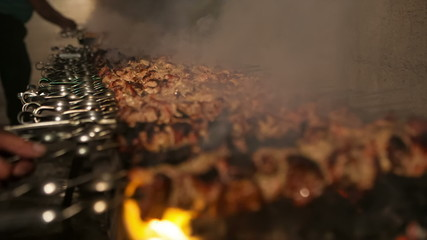 Large number of barbecue cooked on fire