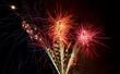 Exploding fireworks bursts close-up - 67559256