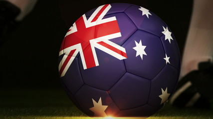 Football player kicking australia flag ball
