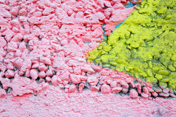 pink and yellow coat on the concrete wall - detail