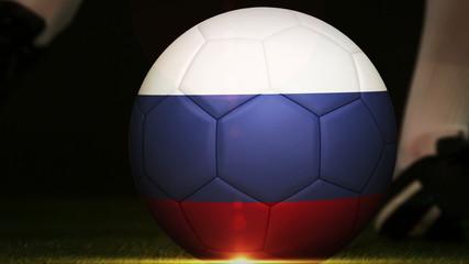 Football player kicking russia flag ball