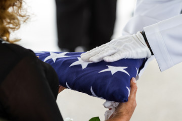 Military funeral, handing the Flag to the widow