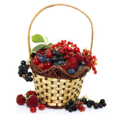 Basket with summer berries isolated