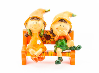 Boy and Girl Dolls sitting on Bench