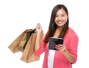 Asian woman with tablet and shopping bag