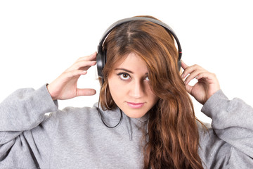 attractive young red haired girl wearing headphones
