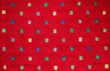 red fabric with colorful pattern