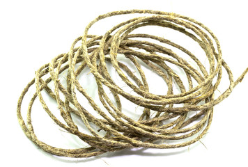 A coil of rope on a white background