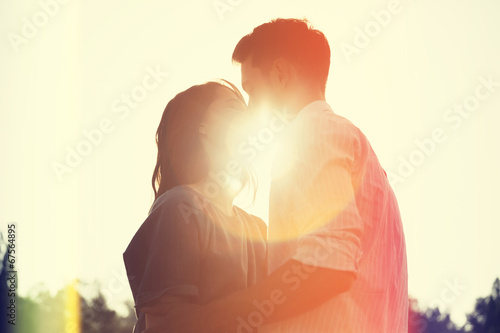Loving couple in the park. Vintage retro style with light leaks - 67564895