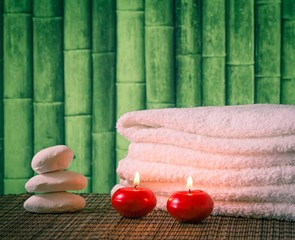 Spa massage border with towel stacked candles and sea salt