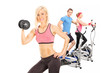 Three athletes exercising with fitness equipment