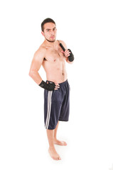 tough martial arts fighter wearing black shorts and wristband