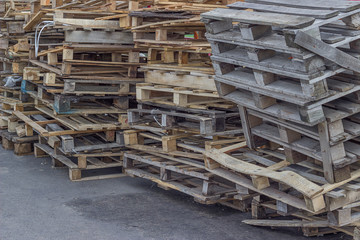 Pile of old and broken wooden pallets