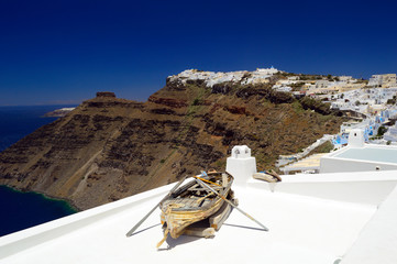 Wooden boat on a roof in Santorini, Cyclades, Greece