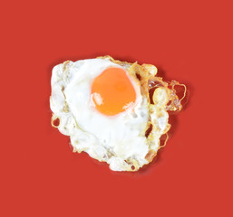 fried egg on a red background