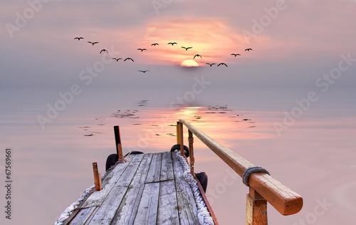 Papiers peints Lac / Etang el sol besando la superficie del mar