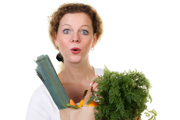 amazed woman with a bag full of vegetables