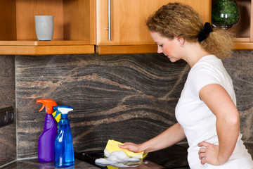 woman cleans the stove