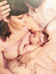 caring loving parents holding cute sleeping little baby girl wit