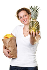 woman shows a pineapple