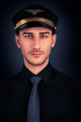 Man with Pilot Hat and Black Shirt Portrait