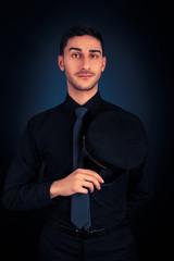 Man with Pilot Hat and Black Shirt Portrait