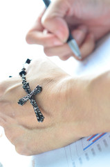 Praying with a rosary on work