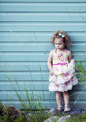 fashion photo of little girl in floral dress