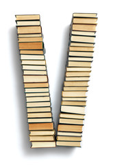 Letter V formed from the page ends of books