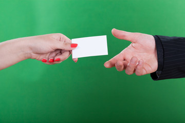 Woman giving man her business card