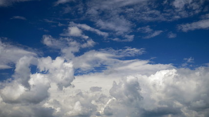 White clouds running over blue sky. Timelapse