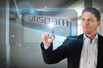 Businessman pointing to word antispam