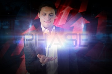 Businessman presenting the word phase