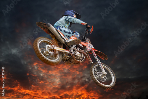 Flying motocross rider fire storm - 67573489